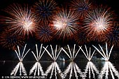australia stock photography | Skyfire 2018 Firework Display over Lake Burley Griffin, Canberra, Australian Capital Territory (ACT), Australia, Image ID AU-CANBERRA-FIREWORKS-SKYFIRE-0002. Skyfire is an annual March fireworks show held over Lake Burley Griffin in Canberra, Australia since 1989. The event is funded by local radio station FM 104.7, and the display is synchronised to a soundtrack of music broadcast on the station. Skyfire 2018 delivered a magnificent display of fireworks as part of The Enlighten Festival. It's Canberra's biggest night of fireworks - and this year the event turns 30. The fireworks display was 18 minutes of extravagant lights and explosions timed to hits provided by 104.7 including some classics from across the 30 years of Skyfire events.