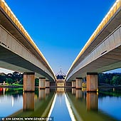 australia stock photography | Commonwealth Bridge at Dawn, Canberra, ACT, Australia, Image ID AU-ACT-CANBERRA-0008. Commonwealth Avenue is a major road in Canberra, Australian Capital Territory, Australia. It connects Civic with South Canberra. Specifically, it runs between City Hill and Capital Hill. The first Commonwealth Avenue Bridge was constructed in 1928. It replaced a ford across the Molonglo River. The road crosses Lake Burley Griffin over the Commonwealth Bridge. The Commonwealth Bridge is a part of a popular 'bridge to bridge' walk - Commonwealth Bridge to Kings Avenue Bridge.