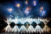 australia stock photography | Skyfire 2018 Firework Display over Lake Burley Griffin, Canberra, Australian Capital Territory (ACT), Australia, Image ID AU-CANBERRA-FIREWORKS-SKYFIRE-0003. Skyfire is an annual March fireworks show held over Lake Burley Griffin in Canberra, Australia since 1989. The event is funded by local radio station FM 104.7, and the display is synchronised to a soundtrack of music broadcast on the station. Skyfire 2018 delivered a magnificent display of fireworks as part of The Enlighten Festival. It's Canberra's biggest night of fireworks - and this year the event turns 30. The fireworks display was 18 minutes of extravagant lights and explosions timed to hits provided by 104.7 including some classics from across the 30 years of Skyfire events.