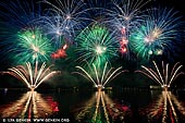 australia stock photography | Skyfire 2018 Firework Display over Lake Burley Griffin, Canberra, Australian Capital Territory (ACT), Australia, Image ID AU-CANBERRA-FIREWORKS-SKYFIRE-0004. Skyfire is an annual March fireworks show held over Lake Burley Griffin in Canberra, Australia since 1989. The event is funded by local radio station FM 104.7, and the display is synchronised to a soundtrack of music broadcast on the station. Skyfire 2018 delivered a magnificent display of fireworks as part of The Enlighten Festival. It's Canberra's biggest night of fireworks - and this year the event turns 30. The fireworks display was 18 minutes of extravagant lights and explosions timed to hits provided by 104.7 including some classics from across the 30 years of Skyfire events.