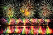 australia stock photography | Skyfire 2018 Firework Display over Lake Burley Griffin, Canberra, Australian Capital Territory (ACT), Australia, Image ID AU-CANBERRA-FIREWORKS-SKYFIRE-0005. Skyfire is an annual March fireworks show held over Lake Burley Griffin in Canberra, Australia since 1989. The event is funded by local radio station FM 104.7, and the display is synchronised to a soundtrack of music broadcast on the station. Skyfire 2018 delivered a magnificent display of fireworks as part of The Enlighten Festival. It's Canberra's biggest night of fireworks - and this year the event turns 30. The fireworks display was 18 minutes of extravagant lights and explosions timed to hits provided by 104.7 including some classics from across the 30 years of Skyfire events.