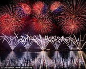 australia stock photography | Skyfire 2018 Firework Display over Lake Burley Griffin, Canberra, Australian Capital Territory (ACT), Australia, Image ID AU-CANBERRA-FIREWORKS-SKYFIRE-0006. Skyfire is an annual March fireworks show held over Lake Burley Griffin in Canberra, Australia since 1989. The event is funded by local radio station FM 104.7, and the display is synchronised to a soundtrack of music broadcast on the station. Skyfire 2018 delivered a magnificent display of fireworks as part of The Enlighten Festival. It's Canberra's biggest night of fireworks - and this year the event turns 30. The fireworks display was 18 minutes of extravagant lights and explosions timed to hits provided by 104.7 including some classics from across the 30 years of Skyfire events.
