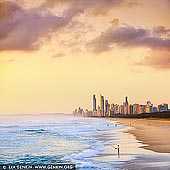 australia stock photography | Surfers Paradise at Sunrise, Gold Coast, QLD, Australia, Image ID AU-GOLD-COAST-SURFERS-PARADISE-0013. View of the Gold Coast from Southport Spit sand pumping jetty at sunrise. The Southport Spit (also referred to as The Spit) lies opposite of Southport to the north of Main Beach, Gold Coast. It is a permanent sand spit that separates the Southport Broadwater from the Pacific Ocean. On the end of The Spit is the Gold Coast Sand Pumping Jetty, a popular destination for fishermen and part of the Gold Coast Seaway's Sand Bypassing System.