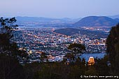 australia stock photography | Hobart at Dusk From Mount Nelson, Tasmania (TAS), Australia, Image ID AU-HOBART-0003. Mount Nelson and Truganini Reserve is a conservation area south of Hobart, Tasmania, Australia. Mount Nelson is 10 minutes' drive from Hobart (five kilometres) en route to Kingston. Originally the site of one of a chain of signal stations that linked Hobart Town with Port Arthur, Mount Nelson is now the location for a restaurant, picnic area and lookout in addition to one of Hobart's oldest residential areas. Here, you can enjoy sweeping views of Hobart and Storm Bay from the lookout or call into Mt Nelson Signal Station Restaurant for great coffee or a delicious light lunch.