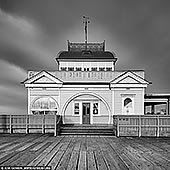 australia stock photography | St Kilda Pavilion, Melbourne, VIC, Australia, Image ID AU-MELBOURNE-0009. Originally known as Parer's Pavilion, The St Kilda Pavilion is a historic landmark which was built in 1904, and sits proudly welcoming any traveler willing to walk the planks, so to speak. In September 2003 the Pavilion was tragically burned to the ground after an arson attack, however the building was restored in March 2006. It was reconstructed using the original plans from 1904 and some parts that were salvaged from the original building.