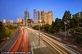 australia stock photography | Melbourne City at Sunrise, Batman Avenue, Melbourne, Victoria, Australia, Image ID AU-MELBOURNE-0023. Busy time in the morning on Batman Avenue in Melbourne, Victoria, Australia while cars, buses and trucks are coming to and from the city.
