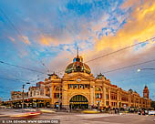 australia stock photography | Flinders Street Station after Sunset, Melbourne, Victoria, Australia, Image ID AU-MELBOURNE-0026. Before Federation Square took the honours, Flinders Street Station was Melbourne's favourite meeting place, hence the catchphrase 'meet me under the clocks'. Flinders Street Station is Australia's oldest train station, and with its distinctive yellow facade and green copper dome it's a city icon. Takeaway stands line the concourse, and the upper floors were purpose-built to house a library, gym and a lecture hall, later used as a ballroom. Flinders Street is the busiest suburban railway station in the southern hemisphere, with over 1500 trains and 110,000 commuters passing through each day. Listed on the Victorian Heritage Register, its 708-metre main platform is the fourth longest railway platform in the world.