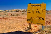 australia stock photography | Warning Sign at White Cliffs Opal Mines, White Cliffs, NSW, Australia, Image ID WHITE-CLIFFS-OPAL-MINES-0001.