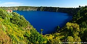 australia stock photography | The Blue Lake Panorama, Mount Gambier, South Australia (SA), Australia, Image ID AU-MOUNT-GAMBIER-0003. The Blue Lake in Mount Gambier, South Australia is a large monomictic lake located in an extinct volcanic maar associated with the Mount Gambier maar complex. It is one of four crater lakes on Mount Gambier. Of the four lakes, only two remain, as the other two (Leg of Mutton and Brown) have dried up over the past 30 to 40 years as the water table has dropped. During December to March, the lake turns to a vibrant cobalt blue colour, returning to a colder steel grey colour for April to November.