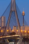 australia stock photography | Anzac Bridge and Sydney Tower at Twilight, Glebe, Sydney, NSW, Australia, Image ID AU-SYDNEY-ANZAC-BRIDGE-0011. Cars and vehicles are travelling to and from Sydney city via Anzac Bridge at the end of the day with blue night sky and buildings highlighted with golden light from street lanterns and sunset.