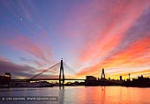 australia stock photography | Sunrise over Anzac Bridge, Glebe, Sydney, NSW, Australia, Image ID AU-SYDNEY-ANZAC-BRIDGE-0013. The vivid colours of the sunrise add to the beauty of the skyline in the City of Sydney in NSW, Australia. The appealing city of Sydney sits under a vivid sunrise in colors of blue, red and gold. The city of Sydney's skyline with its high rise buildings include the tall thin Centre Point Tower in the far distance and the Anzac Bridge in front spanning the Johnstons Bay between Pyrmont and Glebe Island.