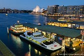 australia stock photography | Circular Quay and Sydney Opera House, Sydney, New South Wales (NSW), Australia, Image ID AU-SYDNEY-CIRCULAR-QUAY-0003. Ferries are waiting for passengers at the Circular Quay wharf in Sydney, Australia while Sydney Opera House highlighted in the background.