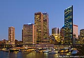 australia stock photography | Circular Quay from Overseas Passenger Terminal, Sydney, New South Wales (NSW), Australia, Image ID AU-SYDNEY-CIRCULAR-QUAY-0004. Close up picture of Circular Quay ferry terminals and Sydney city as the background after sunset.