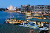 australia stock photography | Ferries at Circular Quay, Sydney, New South Wales (NSW), Australia, Image ID AU-SYDNEY-CIRCULAR-QUAY-0007. Stock photograph of the ferries at the Circular Quay in Sydney with the Sydney Opera House highlighted in the background.