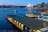 australia stock photography | Circular Quay in the Evening, Sydney, New South Wales (NSW), Australia, Image ID AU-SYDNEY-CIRCULAR-QUAY-0009. Stock image the Circular Quay, major Sydney's transport hub and ferries terminal at dusk.