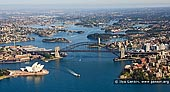 australia stock photography | Aerial View of Sydney City , Sydney, NSW, Australia, Image ID AU-SYDNEY-0011. High altitude aerial photo image of the Sydney Harbour from the air, showing the Sydney Opera House, the Sydney CBD, Circular Quay, the Bridge, the Parramatta River, North Sydney, and Kirribilli.