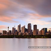 australia stock photography | The Sydney City CBD at Sunrise, Sydney, NSW, Australia, Image ID AU-SYDNEY-0012. Beautiful photo of the Sydney city skyline at sunrise as it was seen on a stormy morning from the shore of Farm Cove in the Royal Botanic Gardens near Mrs Macquarie's Chair in Sydney, NSW, Australia.