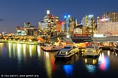 australia stock photography | Darling Harbour at Night, Sydney, New South Wales, Australia, Image ID AU-SYDNEY-DARLING-HARBOUR-0017. Sydney CBD (downtown) after sunset is highlighted with lights and neon signs. Tourists, visitors and locals can enjoy beautiful views of Sydney from the Pyrmont bridge at Darling Harbour.