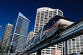 australia stock photography | Sydney City and Monorail, Darling Harbour, Sydney, New South Wales (NSW), Australia, Image ID AU-SYDNEY-DARLING-HARBOUR-0018. Sydney Monorail operates around the main retail area of the central business district (CBD or downtown) running down to Darling Harbour and skirting the harbour, before returning to the city area. A return trip is a good way of getting some perspective on the upper part of the central business district. It also gives you a great elevated look at picturesque Darling Harbour.