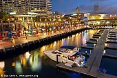 australia stock photography | Cockle Bay Wharf and Marina After Sunset, Darling Harbour, Sydney, NSW, Australia, Image ID AU-SYDNEY-DARLING-HARBOUR-0020. Stock image of the Cockle Bay Wharf and Cockle Bay Marina after sunset in Darling Harbour, Sydney, NSW, Australia. Cockle Bay Marina has facilities for up to 52 vessels, with a maximum length of 15 metres per berth available. Visitors can moor at Cockle Bay for up to three days at a time. Cockle Bay is one of the bays in Darling Harbour, which opens into the much larger Sydney Harbour. The bay is primarily known for Cockle Bay Wharf, a waterfront entertainment area designed by Eric Kuhne that includes a wide variety of restaurants, pubs, clubs, cafes and function venues.
