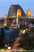 australia stock photography | Sydney Harbour Bridge from Observatory Hill, Sydney, New South Wales (NSW), Australia, Image ID AU-SYDNEY-HARBOUR-BRIDGE-0002. Observatory Hill Park is located in the centre of Sydney, NSW, Australia and it is a popular attraction for locals, workers and tourists boasting one of the City's best terrestrial vantage points for superb panoramic views of Sydney Harbour and the Harbour Bridge. Watching sunset is especially magnificent from that vantage point. Access to Observatory Hill is from Argyle Street in The Rocks.