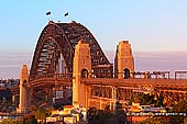 australia stock photography | Sydney Harbour Bridge at Sunset from Observatory Hill, Sydney, New South Wales (NSW), Australia, Image ID AU-SYDNEY-HARBOUR-BRIDGE-0006. Stock photo of the Sydney Harbour Bridge at sunset as it was seen from Observatory Hill in Sydney, NSW, Australia. Bushfires in National Parks polluted air with smoke which and created a very bright red and orange colours at sunset.