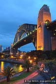 australia stock photography | Sydney Harbour Bridge at Night, Sydney, New South Wales (NSW), Australia, Image ID AU-SYDNEY-HARBOUR-BRIDGE-0014. The Sydney Harbour Bridge is one of Australia's most well known and photographed landmarks. It is the world's largest (but not the longest) steel arch bridge with the top of the bridge standing 134 metres above the harbour. Fondly known by the locals as the 'Coathanger', the Sydney Harbour Bridge celebrates its 80th birthday in 2012, with its official opening in March 1932.