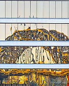 australia stock photography | Harbour Bridge Reflections, Sydney, New South Wales (NSW), Australia, Image ID AU-SYDNEY-HARBOUR-BRIDGE-0018. Abstract image of an office tower in Sydney city reflects the Sydney Harbour Bridge in its shiny windows early in the morning.