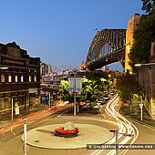 australia stock photography | Harbour Bridge at Night from The Wharf Theatre, Sydney, New South Wales (NSW), Australia, Image ID AU-SYDNEY-HARBOUR-BRIDGE-0030. Night photo of the sculpture by Jimmie Durham, called Still Life With Stone and Car, at the corner of Hickson Road and Pottinger Street in Dawes Point in Sydney, NSW, Australia with the Sydney Harbour Bridge in the background.