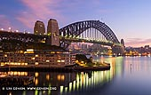australia stock photography | Sydney Harbour Bridge and The Park Hyatt Hotel at Dawn, Sydney, New South Wales (NSW), Australia, Image ID AU-SYDNEY-HARBOUR-BRIDGE-0032. One of the classical and best Sydney's view - The Harbour Bridge and The Park Hyatt Hotel from the observation deck at the Overseas Passenger Terminal. This photographic spot is especially good for watching sunrise or when large cruise ships or liners arriving to Sydney, Australia.