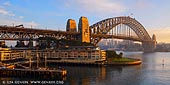 australia stock photography | Sydney Harbour Bridge and The Park Hyatt Hotel on Early Morning, Sydney, NSW, Australia, Image ID AU-SYDNEY-HARBOUR-BRIDGE-0033. Sydney is Australia's best known city and one of the most popular destinations Down Under. Together with the Sydney Opera House the Harbour Bridge are two parts of the 'I was there' photographic record. Major hotels are located at the Circular Quay, the Rocks and the Darling Harbour making sightseeing easy. Sydney Harbour Bridge was 80 years old in 2012, having been officially opened in 1932. The bridge and Sydney Opera House are Sydney's most iconic features. The harbour itself is a major Sydney attraction and harbour cruises - including lunch, dinner or party cruises, in addition to primarily sightseeing ones.