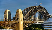 australia stock photography | Sydney Harbour Bridge from Milson's Point, Sydney, New South Wales (NSW), Australia, Image ID AU-SYDNEY-HARBOUR-BRIDGE-0043. Close-up image of the Sydney Harbour Bridge from Milson's Point train station when last rays of the low Sun highlighted the bridge while dark stormy clouds in the background created dramatic effect.