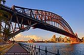 australia stock photography | Harbour Bridge and Sydney Opera House at Sunrise, Milsons Point, Sydney, NSW, Australia, Image ID AU-SYDNEY-HARBOUR-BRIDGE-0045. Stock photograph of the Harbour Bridge and the Sydney Opera House from Luna Park in Milsons Point, Sydney, NSW, Australia at sunrise.