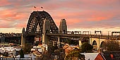 australia stock photography | Sydney Harbour Bridge at Dramatic Sunset, Observatory Hill, Sydney, New South Wales (NSW), Australia, Image ID AU-SYDNEY-HARBOUR-BRIDGE-0046. Panoramic image of The Sydney Harbour Bridge as it was seen from the Observatory Hill during dramatic yellow and pink sunset.