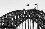 australia stock photography | Sydney Harbour Bridge Arches in Black and White, Sydney, New South Wales (NSW), Australia, Image ID AU-SYDNEY-HARBOUR-BRIDGE-0047. Silhouette of the beautiful Sydney Harbour Bridge steel arches in Sydney, NSW, Australia. The Sydney Harbour Bridge may not be the longest steel-arch Bridge in the world, but it is the largest and widest. At 48.8 metres (151.3 feet) wide, the Guinness Book of Records lists it as the widest long span Bridge in the world and until 1967, it was Sydney's tallest structure. The Sydney Harbour Bridge was not originally thought of as an arch bridge. Dr. John Job Crew Bradfield initially had a cantilever bridge in mind to span the harbour. However, on a trip to New York he was inspired by the Hell Gate Bridge and he realised the cantilever design was inferior to an arch for his proposed bridge.