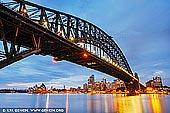 australia stock photography | Sunrise at Harbour Bridge and Sydney Opera House, Milsons Point, Sydney, NSW, Australia, Image ID AU-SYDNEY-HARBOUR-BRIDGE-0049. Calm blue dawn in Sydney, NSW, Australia near the Harbour Bridge and the Sydney Opera House.