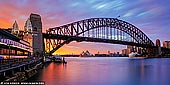 australia stock photography | Panoramic Photo of Harbour Bridge and Sydney Opera House, Milsons Point, Sydney, NSW, Australia, Image ID AU-SYDNEY-HARBOUR-BRIDGE-0050. Panoramic image if colourful stormy sunrise in Sydney as it was seen from Milsons Point overlooking the Harbour Bridge, Sydney Opera House and Luna Park.