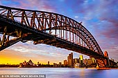 australia stock photography | Sunrise at Harbour Bridge and Sydney Opera House, Milsons Point, Sydney, NSW, Australia, Image ID AU-SYDNEY-HARBOUR-BRIDGE-0051. Colourful stormy sunrise in Sydney as it was seen from Milsons Point overlooking the Harbour Bridge and Sydney Opera House.