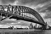 australia stock photography | Sydney Harbour Bridge and Opera House, Sydney, New South Wales (NSW), Australia, Image ID AU-SYDNEY-HARBOUR-BRIDGE-0021. Milsons Point is one of the places with spectacular views of the Opera House, Harbour Bridge and the rest of Sydney. This dramatic beautiful black and white photo of the Sydney Harbour Bridge (Sydney's greatest tourism icon) together with another Sydney's icon - the Opera House was created near Luna Park at Milsons Point.