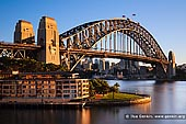 australia stock photography | Sydney Harbour Bridge and The Park Hyatt Hotel in the Morning, Sydney, New South Wales (NSW), Australia, Image ID AU-SYDNEY-HARBOUR-BRIDGE-0022. The iconic Park Hyatt Sydney Hotel is located in the historic Rocks precinct next to the Sydney Harbour Bridge with a view across the harbour towards the Sydney Opera House. The hotel re-opened in early 2012 after being closed for almost a year for an upgrade. The new contemporary interior design takes it's influence from the surrounding Rocks.