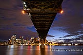 australia stock photography | Under The Harbour Bridge at Night, Sydney, New South Wales (NSW), Australia, Image ID AU-SYDNEY-HARBOUR-BRIDGE-0027. Stunning night photo of the Sydney Harbour Bridge and Sydney city at night, made from Milsons Point in Sydney, New South Wales, Australia.