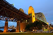 australia stock photography | Sydney Harbour Bridge at Twilight from Bradfield Park, Sydney, New South Wales (NSW), Australia, Image ID AU-SYDNEY-HARBOUR-BRIDGE-0028. Sydney Harbour is world-renowned for its beauty and its famous Sydney Harbour Bridge. This is just one of seven magnificent bridges that complete the loop around the harbour. Every bridge has an interesting history behind it. Fondly known by locals as the 'Coat-hanger', the Sydney Harbour Bridge is one of Australia's best known and photographed landmarks. It is the world's largest (but not the longest) steel arch bridge with the top of the bridge standing 134 metres above the harbour.