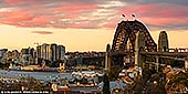 australia stock photography | Sydney Harbour Bridge and Vivid Sunset, Observatory Hill, Sydney, New South Wales (NSW), Australia, Image ID AU-SYDNEY-HARBOUR-BRIDGE-0042. Panoramic image of The Sydney Harbour Bridge as it was seen from the Observatory Hill during vivid yellow and pink sunset.