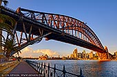 australia stock photography | Harbour Bridge and Sydney Opera House at Sunrise, Milsons Point, Sydney, NSW, Australia, Image ID AU-SYDNEY-HARBOUR-BRIDGE-0045. Stock photograph of the Harbour Bridge and the Sydney Opera House from Luna Park in Milsons Point, Sydney, NSW, Australia at sunrise.