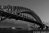 australia stock photography | Harbour Bridge at Sunset from Luna Park, Sydney, New South Wales, Australia, Image ID AUHB0036. Black and White (B&W) photo of the famous Sydney and Australian icon - Sydney Harbour Bridge. Image was created after sunset from Luna Park.