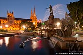 australia stock photography | Archibald Fountain at Night, Hyde Park, Sydney, NSW, Australia, Image ID AU-SYDNEY-HYDE-PARK-0003. Stock image of the Archibald Fountain in the Hyde Park in Sydney, Australia at night with St Mary's Cathedral in the background.