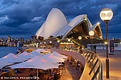 australia stock photography | Friday Evening at Sydney Opera House, Sydney, NSW, Australia, Image ID AU-SYDNEY-OPERA-HOUSE-0004. Opera Bar near the Sydney Opera House offers one of the most amazing views of the Sydney Opera House, Harbour Bridge and the city. It is a very popular place among Sydney visitors, tourists and locals. And it's just a short stroll past Circular Quay and it is the perfect Sydney destination to meet friends with the best backdrop in Sydney.