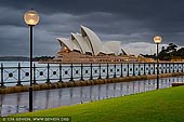 australia stock photography | Sydney Opera House on a Rainy Morning, Sydney, NSW, Australia, Image ID AU-SYDNEY-OPERA-HOUSE-0035. The Sydney Opera House on a cloudy and rainy morning with dramatic clouds above while city lights are still shining.