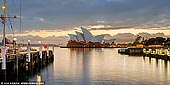 australia stock photography | Sydney Opera House at Sunrise, Sydney, NSW, Australia, Image ID AU-SYDNEY-OPERA-HOUSE-0046. Panoramic image of the Opera House in Sydney, NSW, Australia on a stormy morning from Overseas Passengers Terminal.