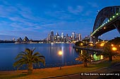 australia stock photography | Sydney CBD Skyline with the Opera House and Harbour Bridge at Dawn, Kirribilli, Sydney, NSW, Australia, Image ID AU-SYDNEY-OPERA-HOUSE-0011. Stock image of Sydney Opera House and Harbour Bridge at Dawn, Sydney, NSW, Australia. This photo was taken from the harbour shore in the Kirribilli suburb, which has fantastic views across the harbour to Sydney Harbour Bridge, Opera House and Sydney city.